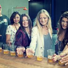Tour guests sample AIB Beer